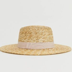 Straw wife brim hat with pink ribbon